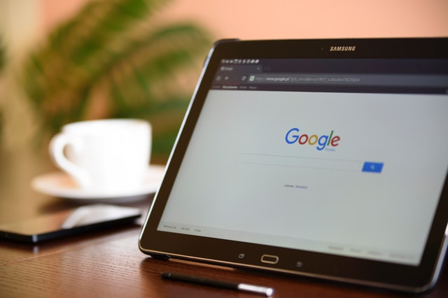 A tablet with the google screen pulled up
