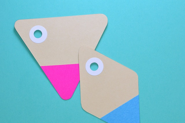 Two triangles cut out of paper on a blue background