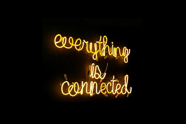 a neon sign that says everything is connected