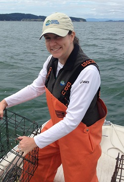 Elsa Schwartz, Island MRC member shown out crabbing with Puget Sound in the background