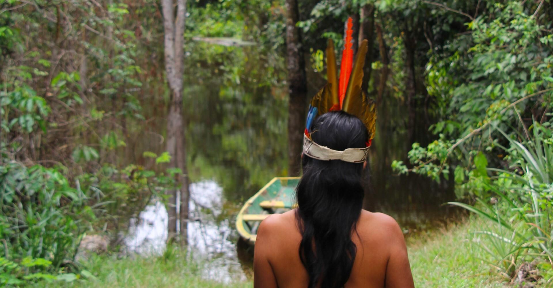 Photo: Edgar Kanaykõ Indigenous Person walks toward river