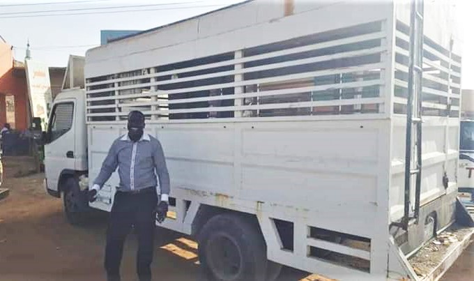 The Rev. Philemon Hassan Kharata with Baptist church truck confiscated in 2012. (Facebook)