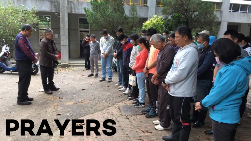 School leaders meet to pray after the fire.