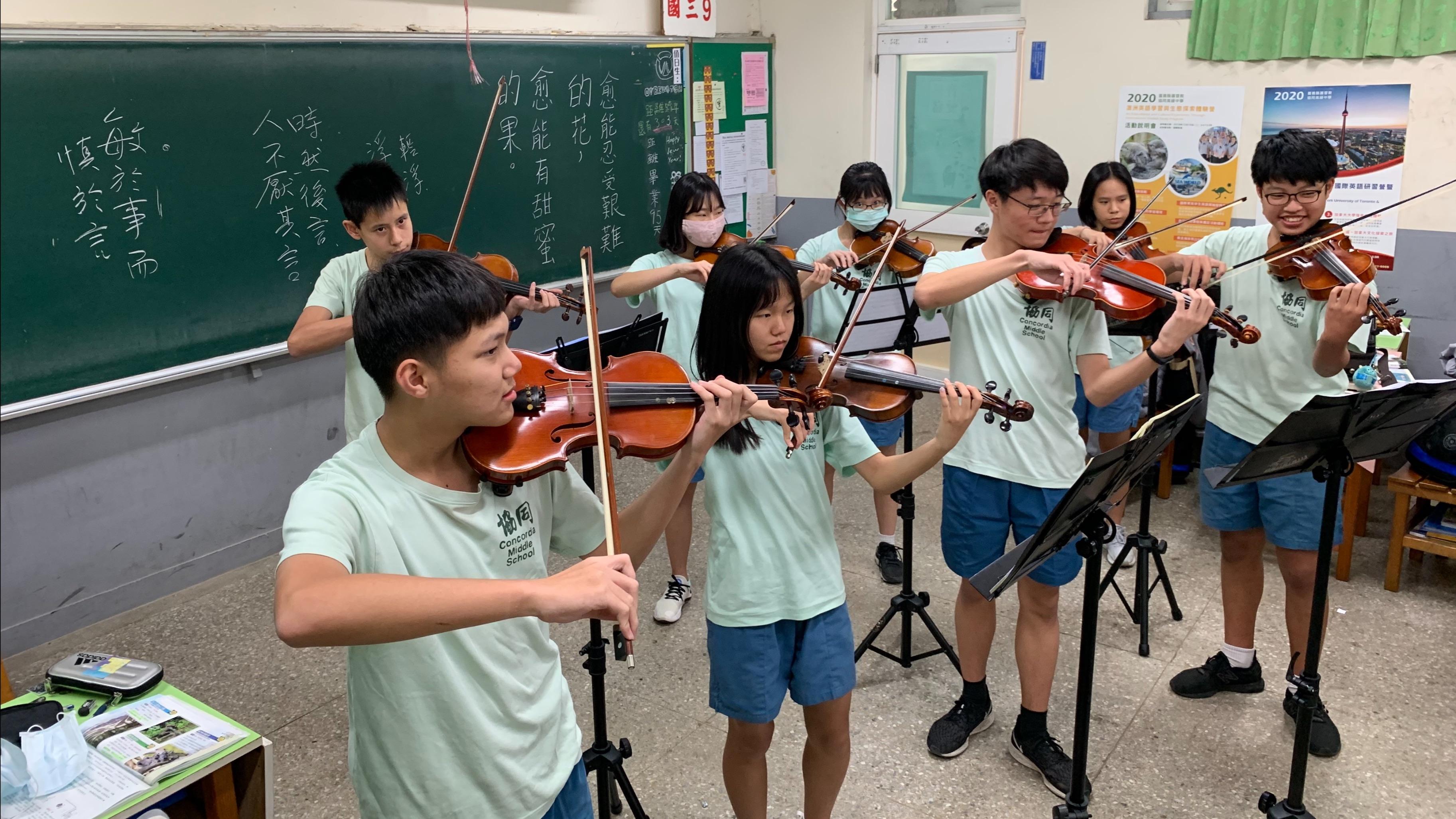 Bilingual students perform a special classroom concert