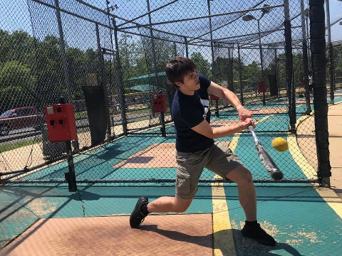 Swinging the bat at the batting cages
