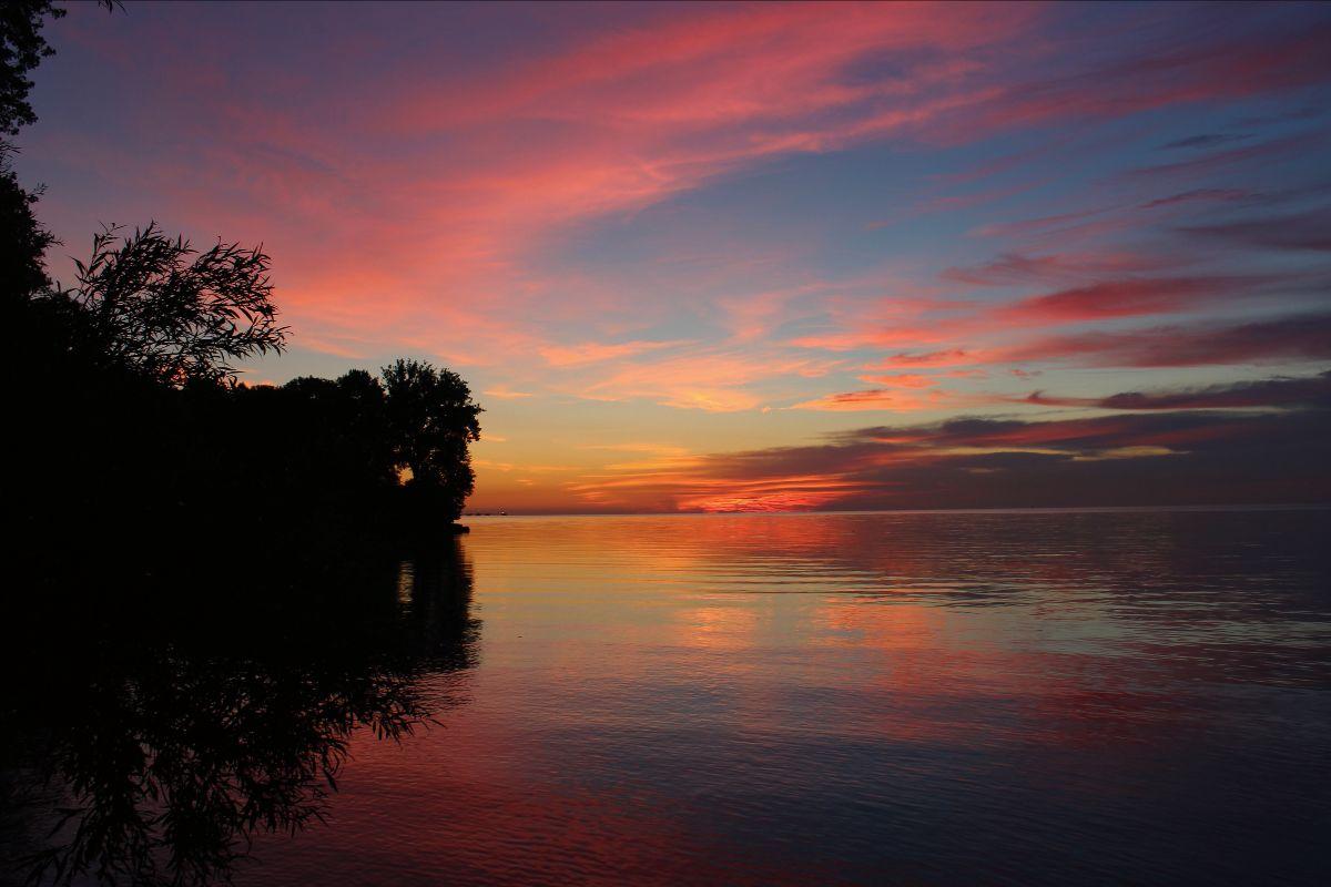 pink and orange sunset over lake