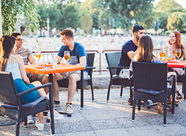 People sitting outside enjoying a meal