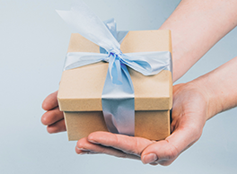 Someone holding a gift-wrapped box