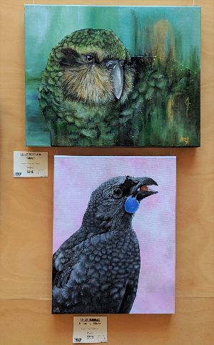 Two paintings featuring birds