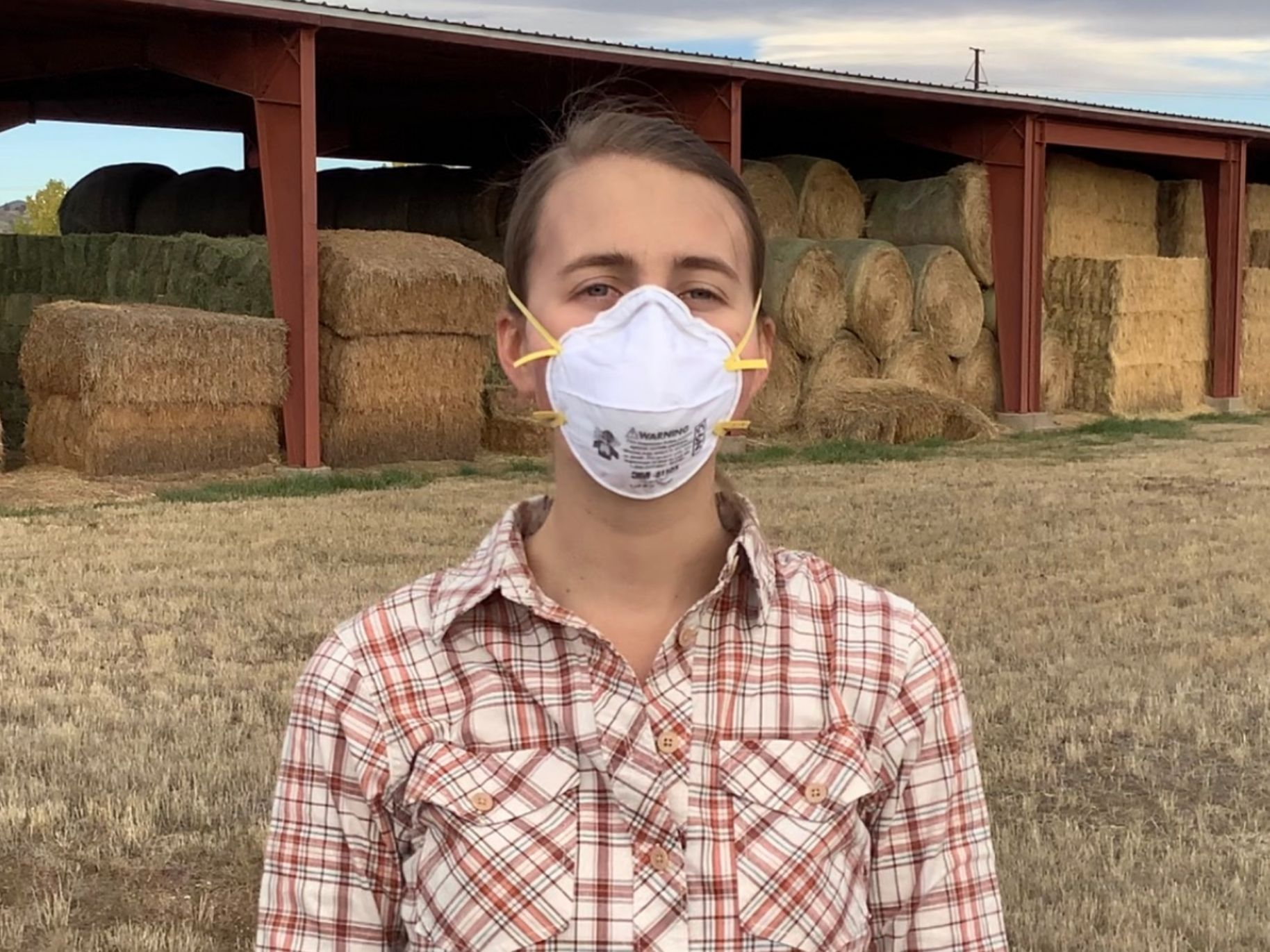Woman wearing and N95 respirator on the farm.