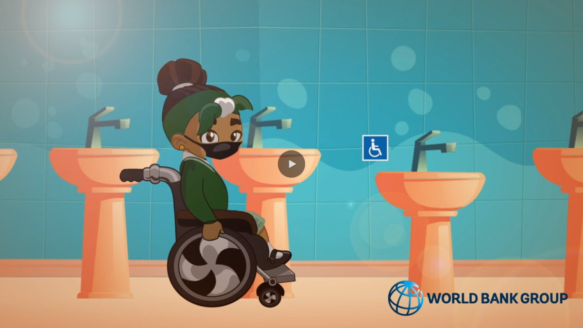 Jozy is in an accessible bathroom, getting ready to sanitize her wheelchair
