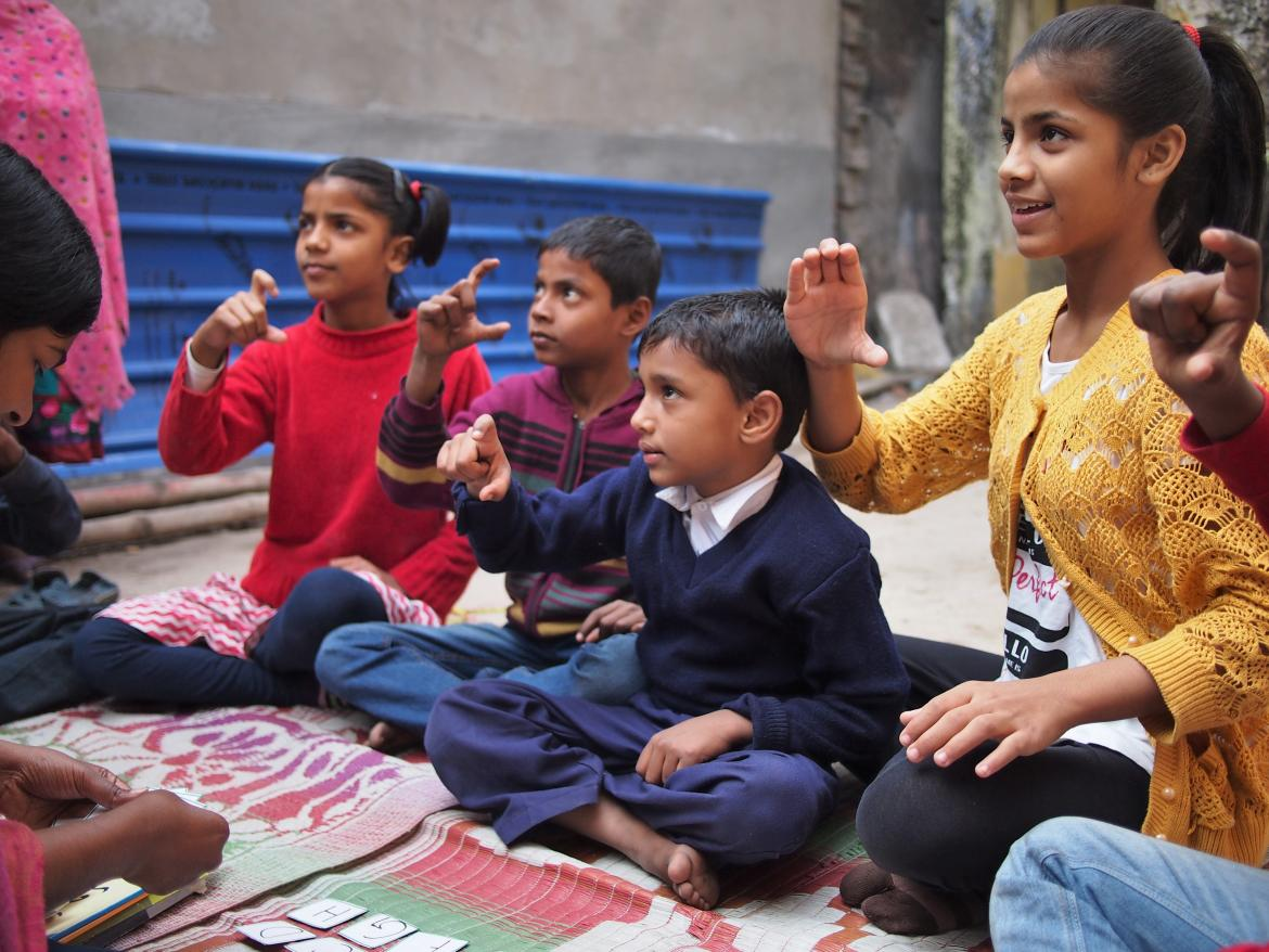 Children learning Indian Sign Language together at Child in Need Institute.