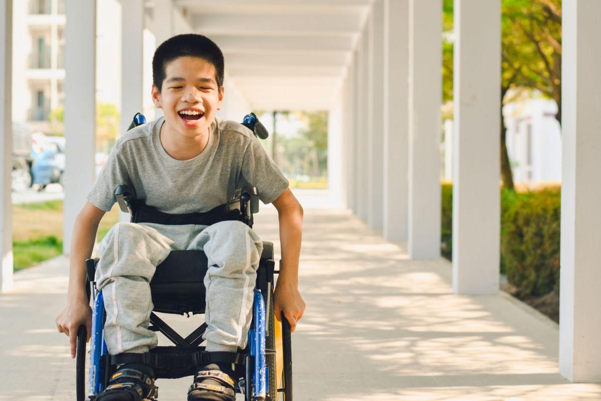 A children in a wheelchair smiling