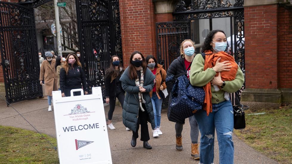 Graduate students walk through the Van Wickle Gates