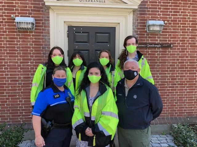 Safewalkers posing in neon vests and masks