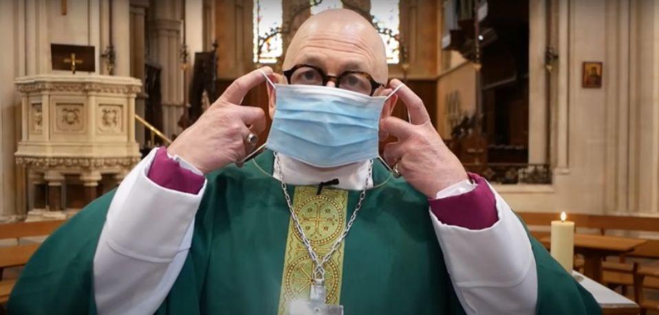 Bishop Kevin demonstrating a mask