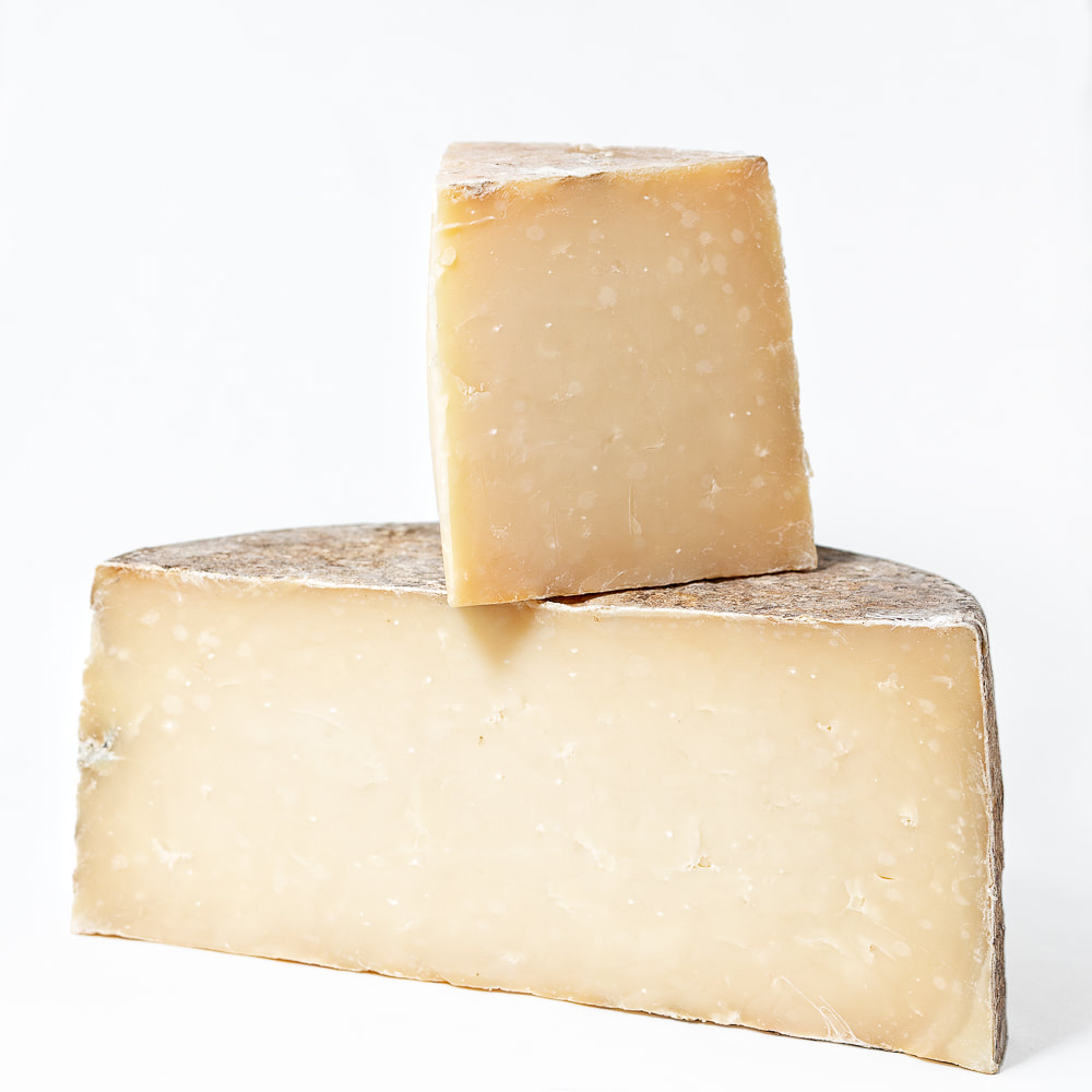 Two chunks of cheese stacked