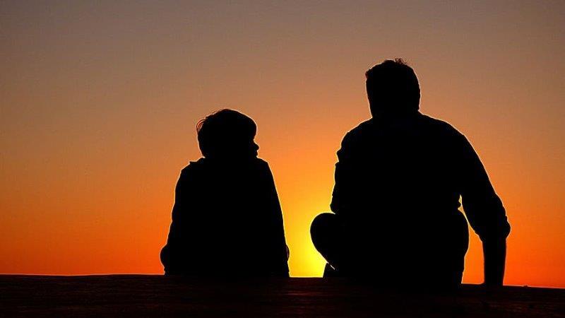 silhouette father son sundown