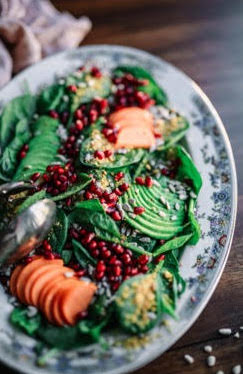 Leafy Salad with fruits in decorate plate on table