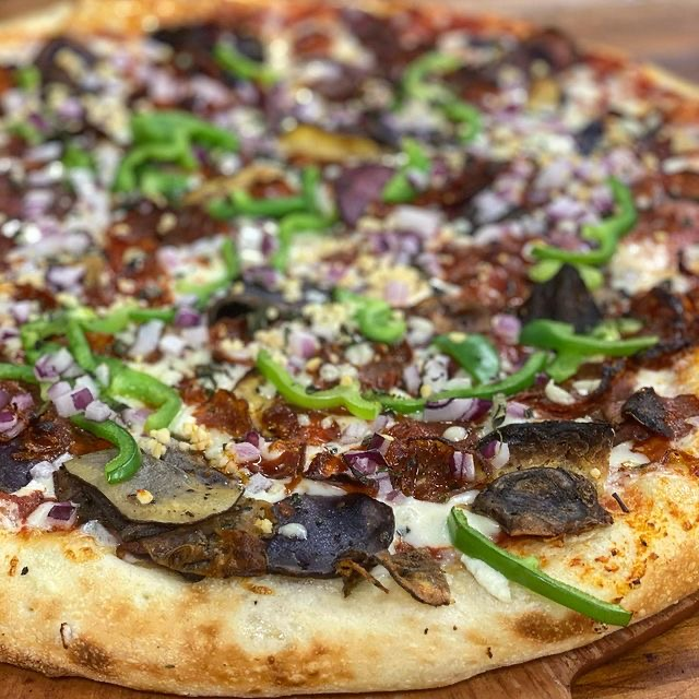 fuel your stoke and eat this local delicious pizza with beers