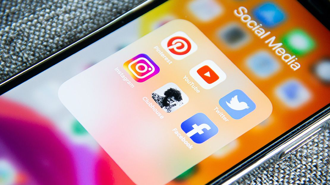 Photo of iPhone screen showing icons for the following social media platforms: Pinterest, Youtube, Twitter, Instagram, Clubhouse and Facebook
