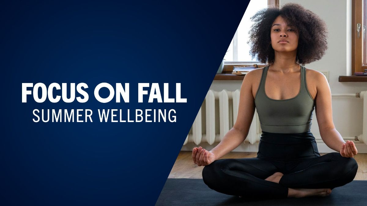 Woman sitting cross-legged doing yoga, text reads: Focus on Fall: summer wellbeing
