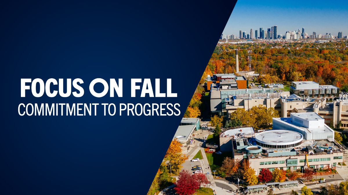 Overhead shot of the UTM campus showing a large square concrete building and the Mississauga city skyline in the background. To the left of the image is a blue background with white text that reads: Focus on Fall: commitment to progress