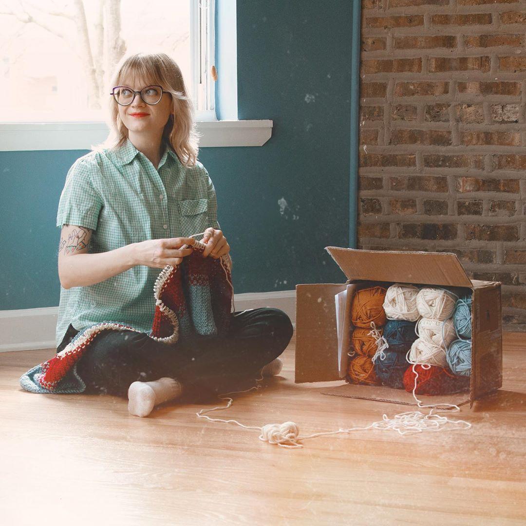 Heidi Gustad knitting at home.