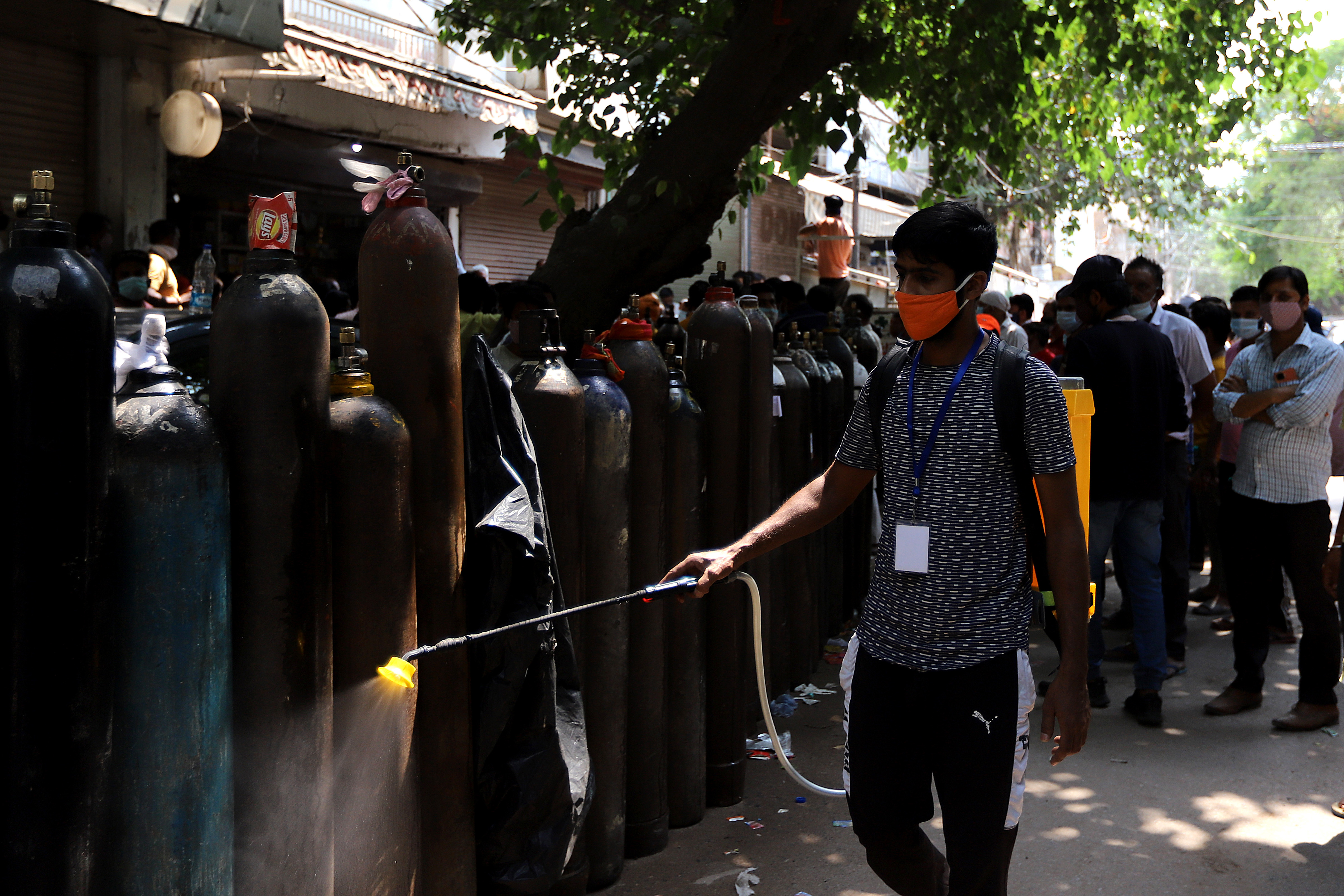 On 2 May 2021, Javed Alam, a 34-year-old student of UN volunteers, sanitize oxygen cylinders outside a refilling centre in New Delhi, India.