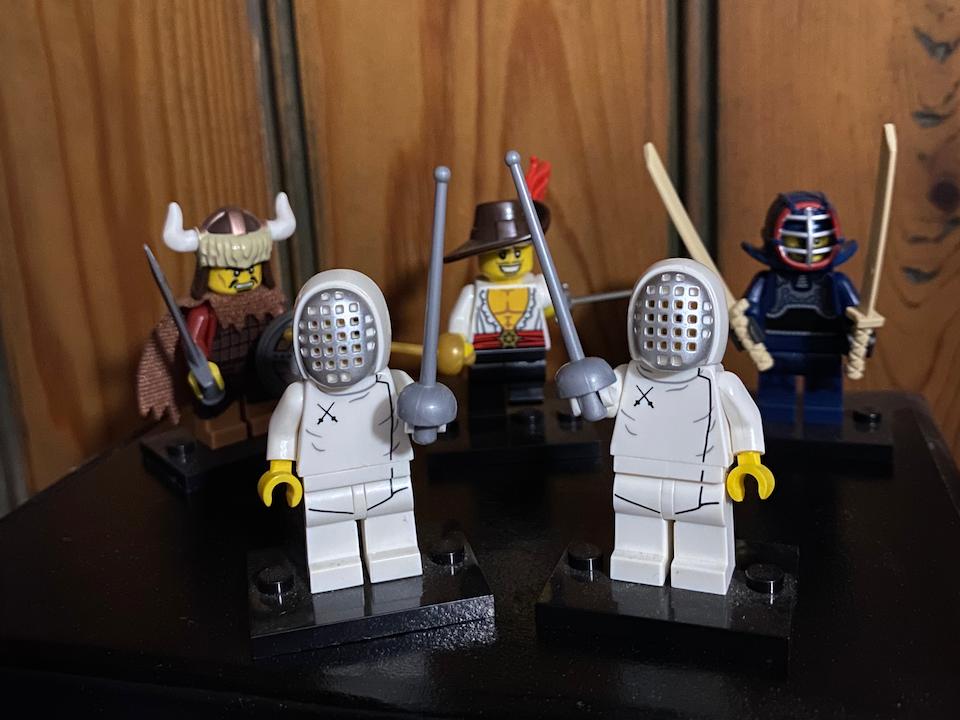 Lego fencers salute