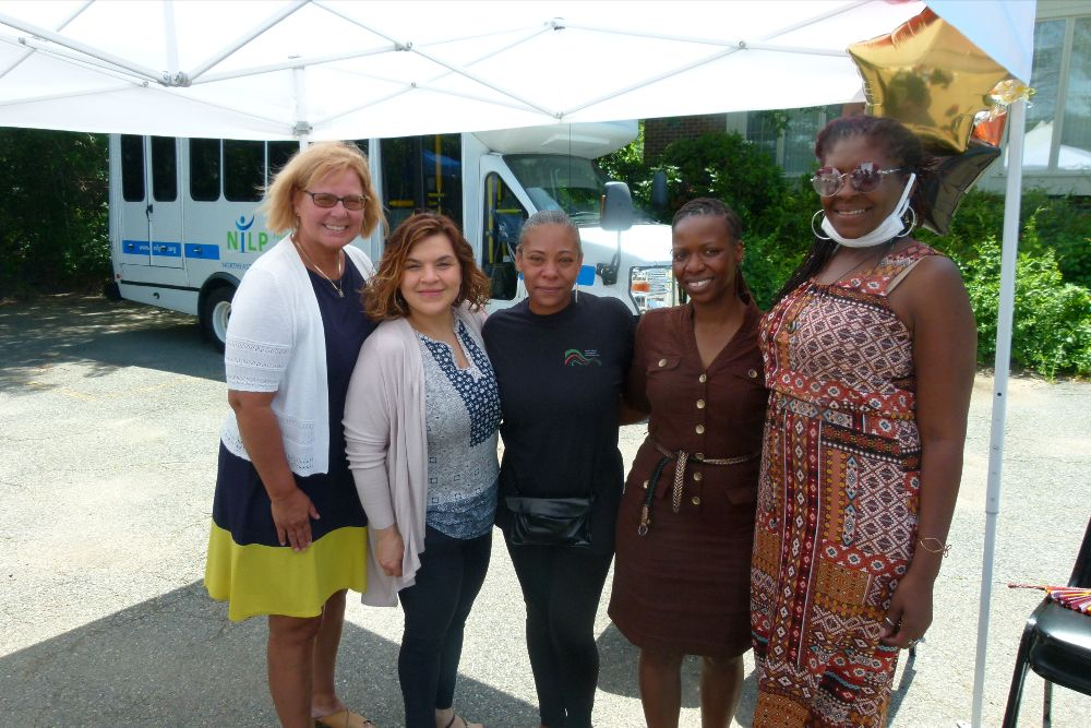 NILP's CEO with Nicole McClain from the North Shore Juneteenth Association and NILP staff members Lynette, Helina and Michelle