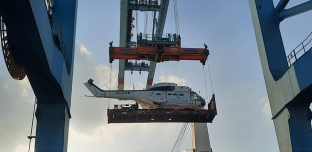 A picture containing text, sky, power shovel, sailing vessel  Description automatically generated