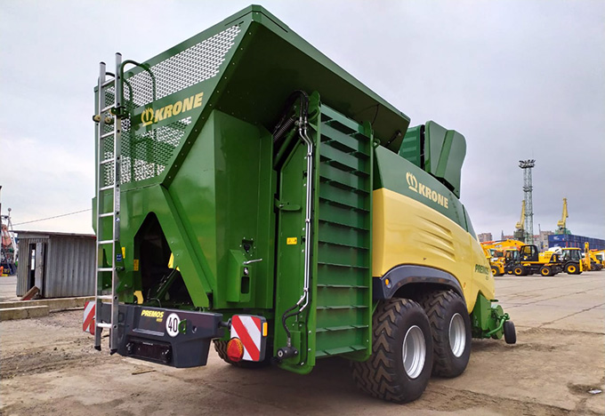 A picture containing outdoor, truck, green, machine  Description automatically generated