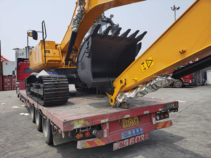 A picture containing truck, road, outdoor, digger  Description automatically generated