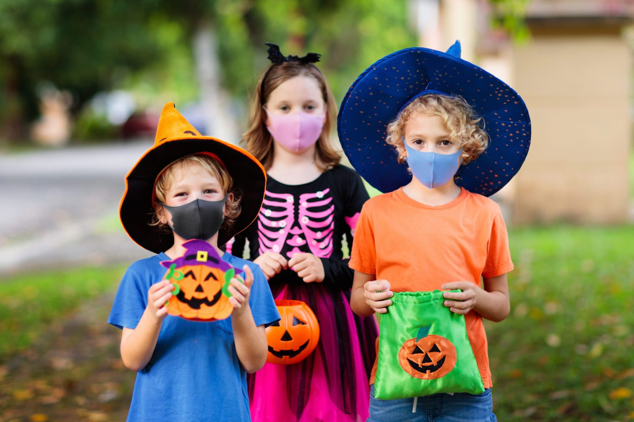 Trick or treaters with masks on