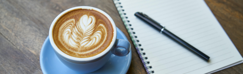 Picture of coffee and notebook