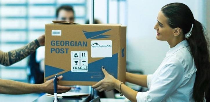 Georgian post office - lady handing in a box