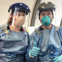 2 doctors wearing face shields and masks