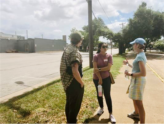 Three Walkable Arlington members discussing the walkability of downtown while conducting a walk audit