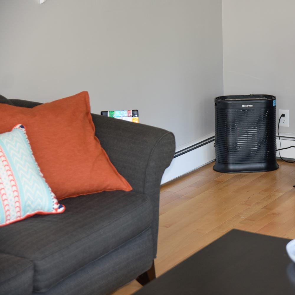 Air purifier in corner of living room