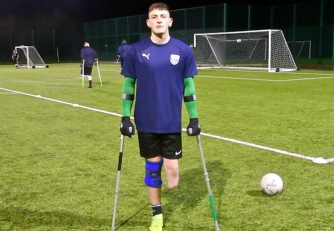 Amputee Richie Wintle playing football