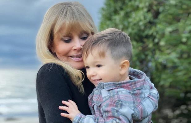 Actress Britt Ekland with her grandson