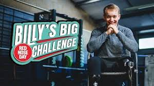 Billy Monger smiling next to a banner saying: Billy's Big Challenge, Red Nose Day