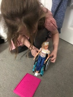 Kirstie plays with Wheelchiar Barbie