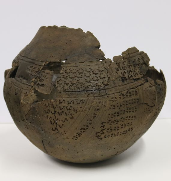 reconstructed urn, with fragments missing