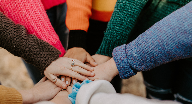 Joining hands image by Hannah Busing, UnSplash