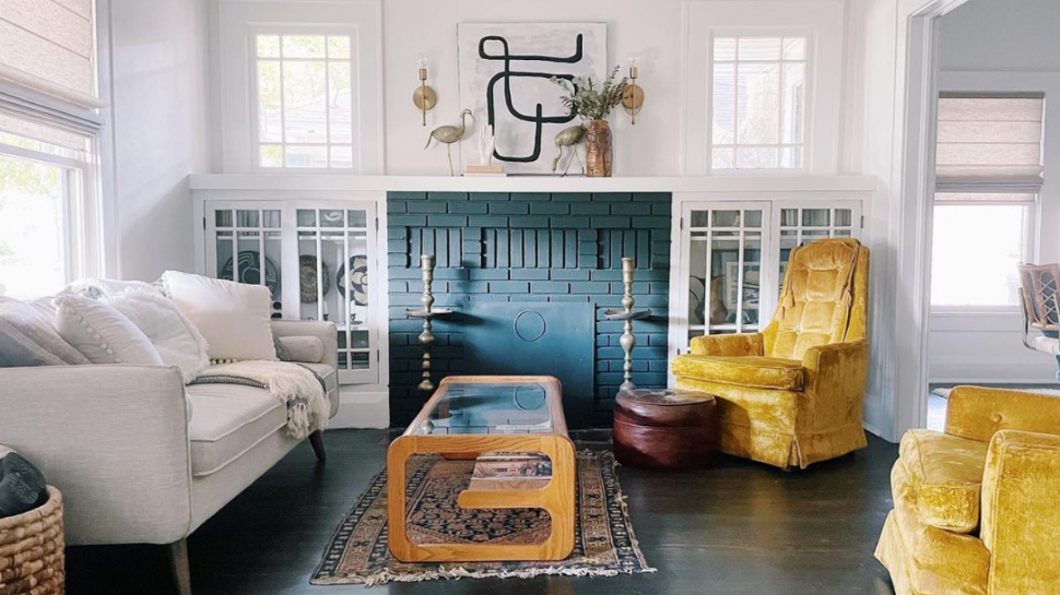 Living room with painted fireplace and accent furniture.