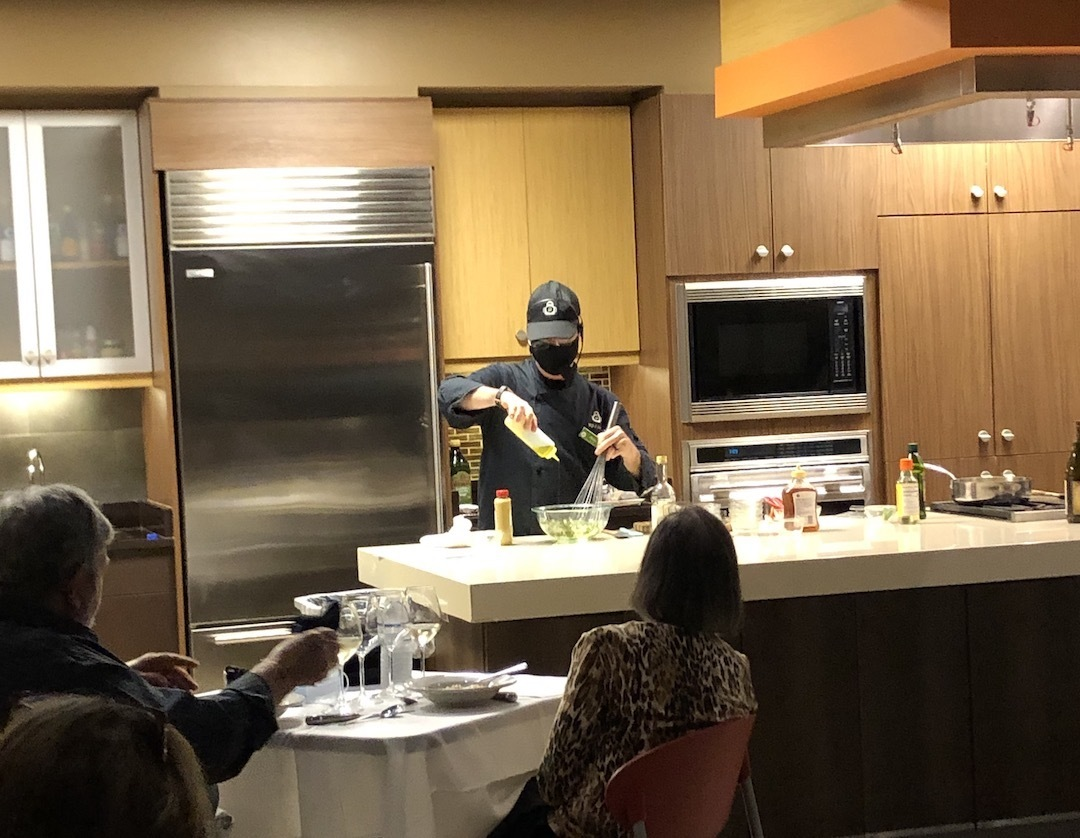 Chef demonstrating a cooking technique