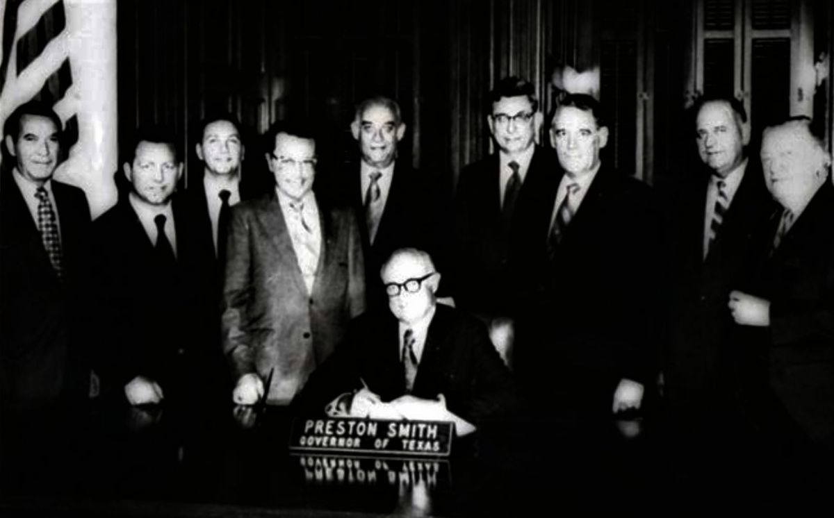 Photo of governor preston smith signing SB 338 into law in 1971)