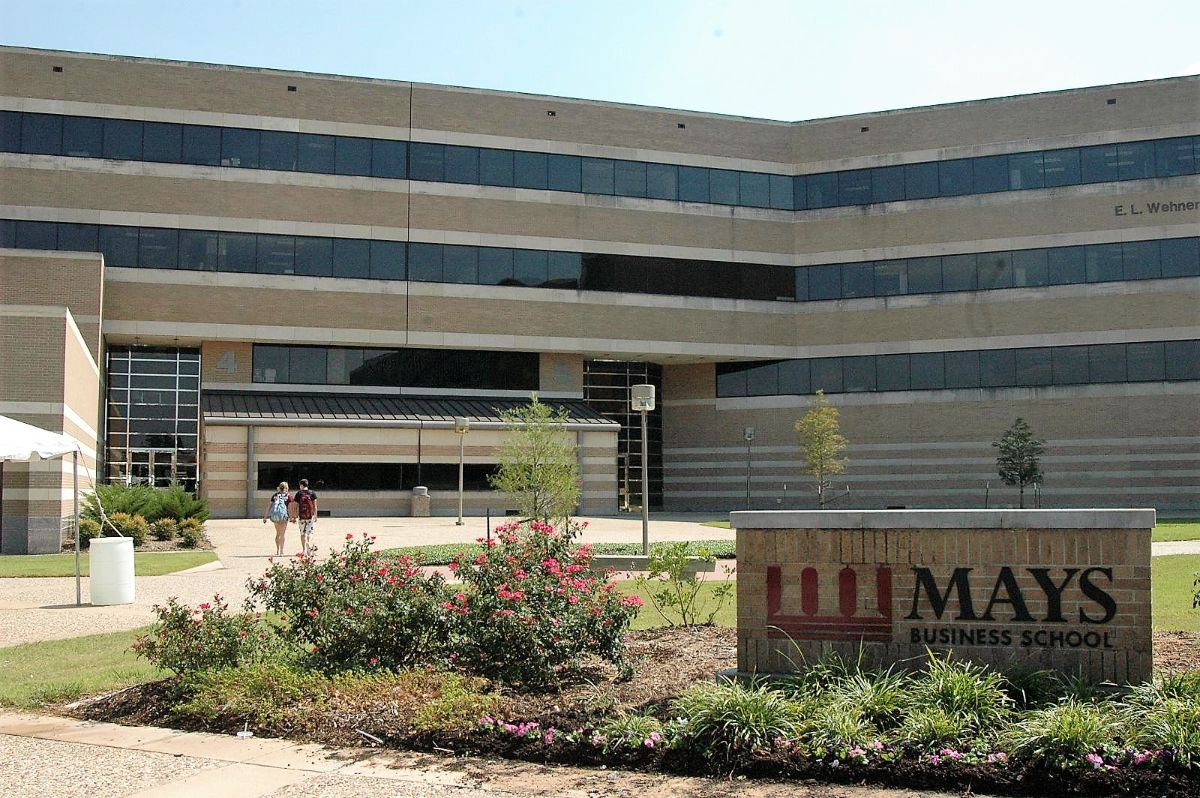 Exterior of E.L. Wehner building in College Station with Mays Business School sign in the foreground